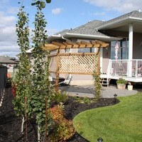 Acreage landscaping design including patio design with walkways and flower garden ideas.