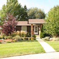 A beautiful bungalow landscaping front yard plan including walkways, patio design and flower garden ideas.