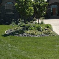 Estate landscaping for big backyards with walkways and flower garden ideas.