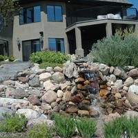 Estate landscaping for big backyards with walkways, water features and flower garden ideas.