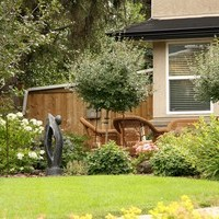 Mature lot garden design including patio design and flower garden ideas.