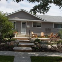 A beautiful bungalow landscaping front yard plan including walkways and patio design.
