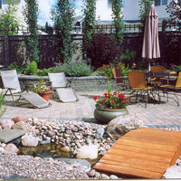 Backyard planning for bungalow landscaping including walkways, patio design and water features.