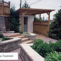 Beautiful bungalow landscaping backyard design including walkways and patio design.