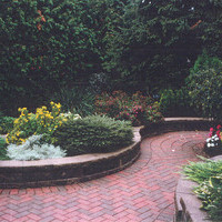 After photo of beautiful bungalow landscaping backyard design including walkways, patio design and flower garden ideas.