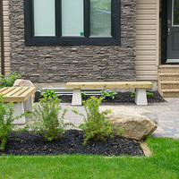 Small front yard landscaping including patio design, walkways and flower garden ideas.