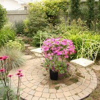 Rejuvenate your mature lot with a garden design including a backyard design with flower garden ideas and walkways.
