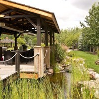 Acreage landscaping design for a large yard including water features and a patio design with walkways.
