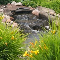 Acreage landscaping design for a large yard including water features and garden fountains.