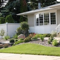 Beautiful bungalow landscaping design including walkways and patio design.