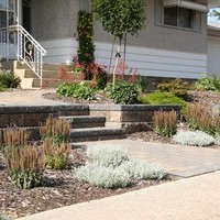 Beautiful bungalow landscaping front yard design including walkways and flower garden ideas.