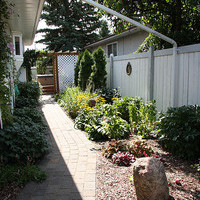 Beautiful bungalow landscaping design including walkways and flower garden ideas.