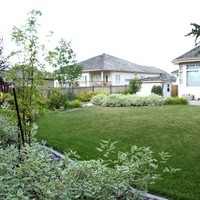 Estate landscaping including flower garden ideas.