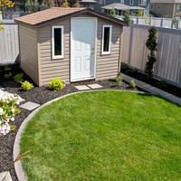 Small backyard landscaping including patio design, walkways and flower garden ideas.