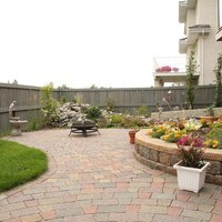 Patio design was included in the landscape design plan to make the most of this small backyard landscaping.