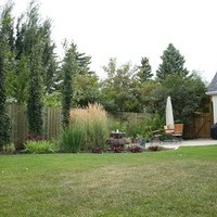 Backyard garden design ideas for a mature lot including patio design and flower garden ideas.