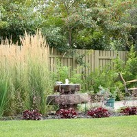Mature lot garden design plan including fountains and flower garden ideas.