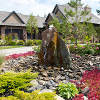 Estate landscaping including amazing water features, garden fountains and flower garden ideas.
