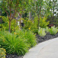 Estate landscaping including walkways and flower garden ideas.