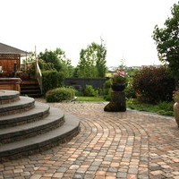 Garden pictures of the landscape design for a pie shaped lot including patio design and flower garden ideas.