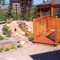 Landscape design for a pie shaped lot including patio design, water features, walkways and flower garden ideas.
